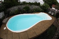 Mandalay Bay Fiberglass Pool and Spa in Brightwaters, NY